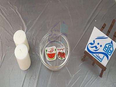 قرار دادن ترانسفر در آب برای دکوپاژ شمع با ترانسفر