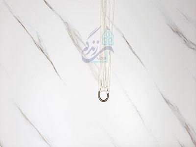 سر انداختن نخ به دور حلقه برای ساخت آویز گلدان مکرومه